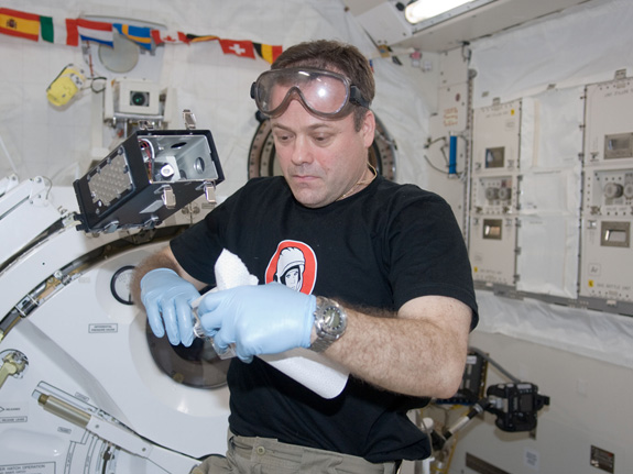 Working in the KIBO Experiment Module (KIBO means 'hope') on a Japanese Space Agency (JAXA) investigation of how plants sense gravity and use it for growth. It's a great experience to be working in the laboratory I helped install during my mission aboard the space shuttle Discovery in 2008.